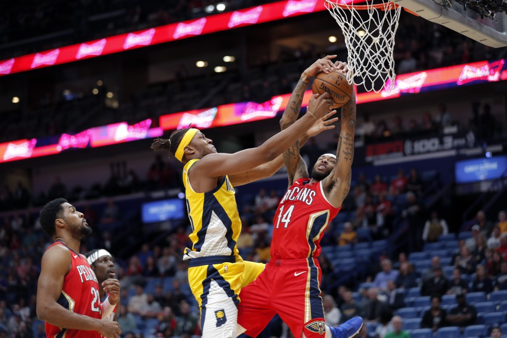 New Orleans Pelicans forward Brandon Ingram (14) and Indiana Pacers center Myles Turner battle under the basket during the first half of an NBA basket...