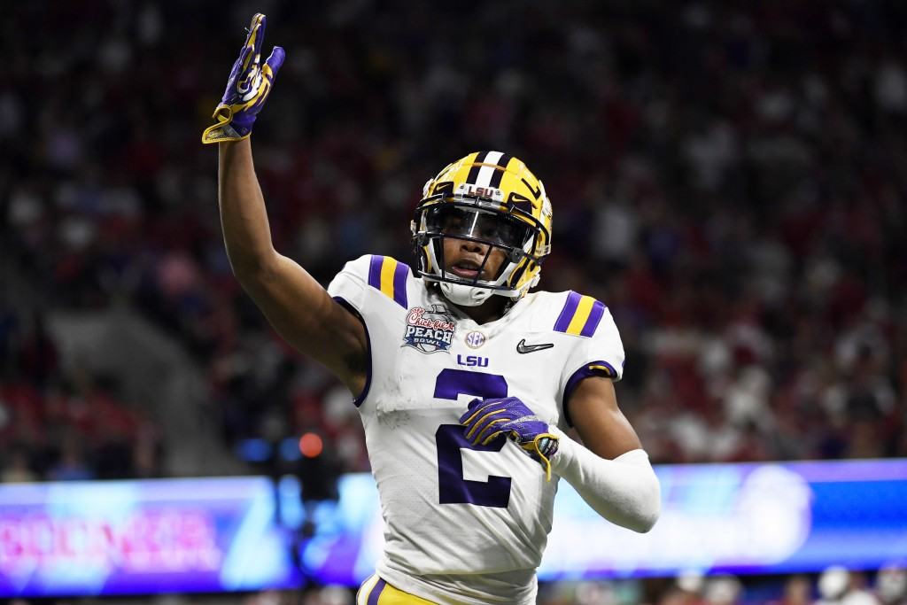 LSU wide receiver Justin Jefferson (2) celebrates his touchdown against Oklahoma during the first half of the Peach Bowl NCAA semifinal college footba...