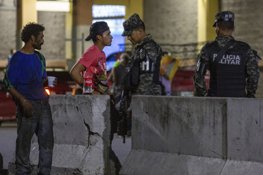 Military police patrol the main bus station in San Pedro Sula, Honduras, on Nov. 28, 2019. Until a few months ago, the bus station was crowded with mi...