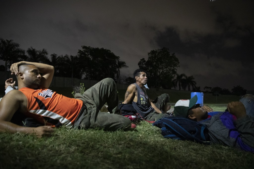 Hondurans deported from Mexico rest near a bus terminal in San Pedro Sula, Honduras, on Nov. 28, 2019, waiting for transportation to continue the trip...