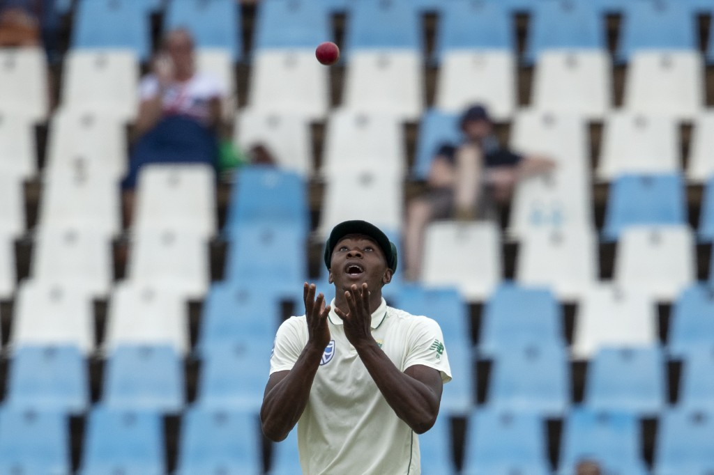 South Africa's Kagiso Rabada stands under the ball to take a catch and dismiss England's batsman Rory Burns for 84 runs on day four of the first crick...