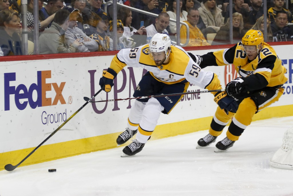 Nashville Predators' Roman Josi (59) brings the puck around the net as Pittsburgh Penguins' Patric Hornqvist (72) pursues during the second period of ...