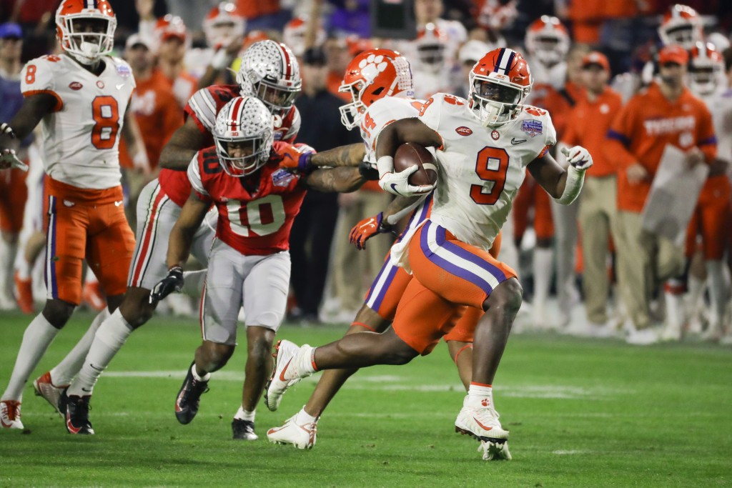 Clemson running back Travis Etienne runs for a touchdown against Ohio State during the second half of the Fiesta Bowl NCAA college football playoff se...