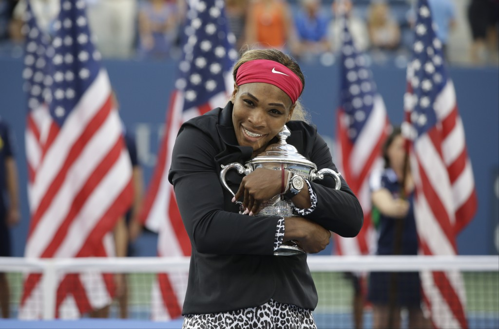 File-This Sept. 7. 2014, file photo shows Serena Williams, of the United States, hugging the championship trophy after defeating Caroline Wozniacki, o...
