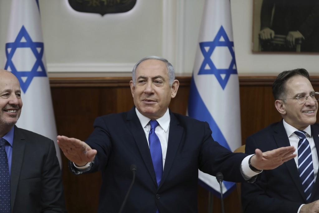 Israeli Prime Minister Benjamin Netanyahu, center, Minister for Regional Cooperation Tzachi Hanegbi, left, and Cabinet Secretary Tzahi Braverman atten...