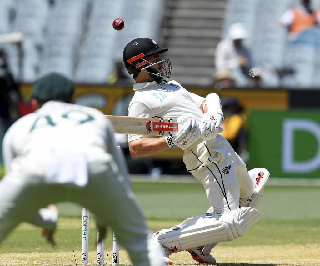 New Zealand's Kane Williamson avoids a bouncer from Australia's Pat Cummins during their cricket test match in Melbourne, Australia, Sunday, Dec. 29, ...
