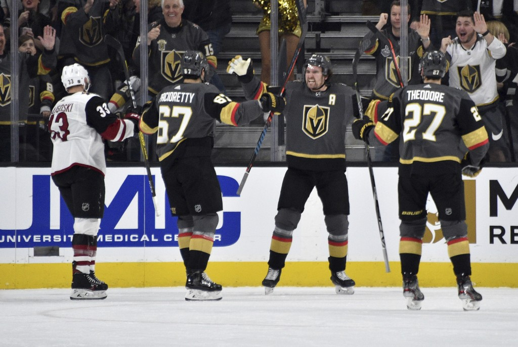 Vegas Golden Knights right wing Mark Stone (61) reacts after scoring against the Arizona Coyotes during the first period of an NHL hockey game Saturda...