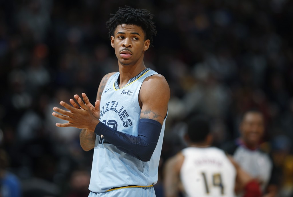 Memphis Grizzlies guard Ja Morant takes the court to face the Denver Nuggets in the first half of an NBA basketball game Saturday, Dec. 28, 2019, in D...
