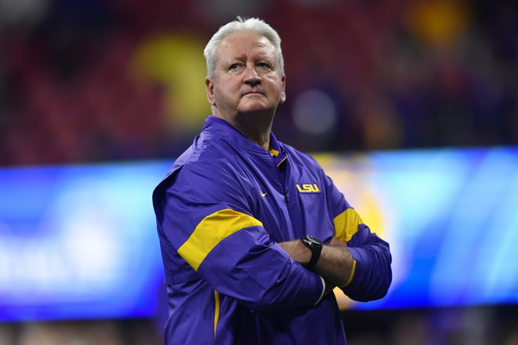 LSU Offensive Coordinator Steve Ensminger watches teams warm up before the first half of the Peach Bowl NCAA semifinal college football playoff game b...