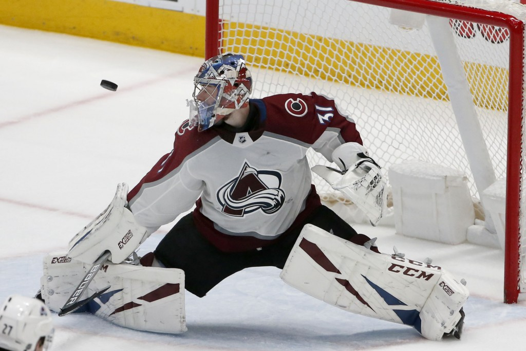 Colorado Avalanche goaltender Philipp Grubauer (31) makes a save against the Dallas Stars during the second period of an NHL hockey game in Dallas, Sa...
