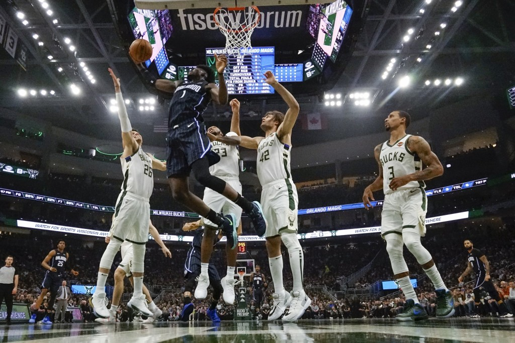 Orlando Magic's Jonathan Isaac shoots during the first half of an NBA basketball game against the Milwaukee Bucks Saturday, Dec. 28, 2019, in Milwauke...