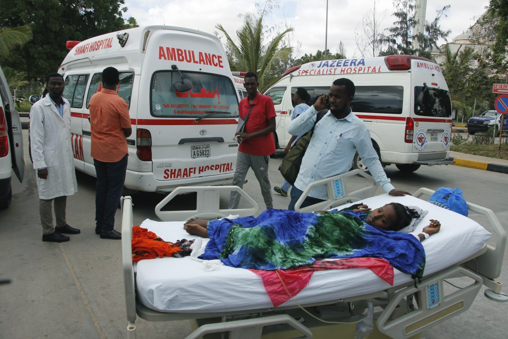 Medical personnel carry a wounded person to be airlifted to the Turkish capital for treatment after they were injured in Saturday's car bomb blast in ...