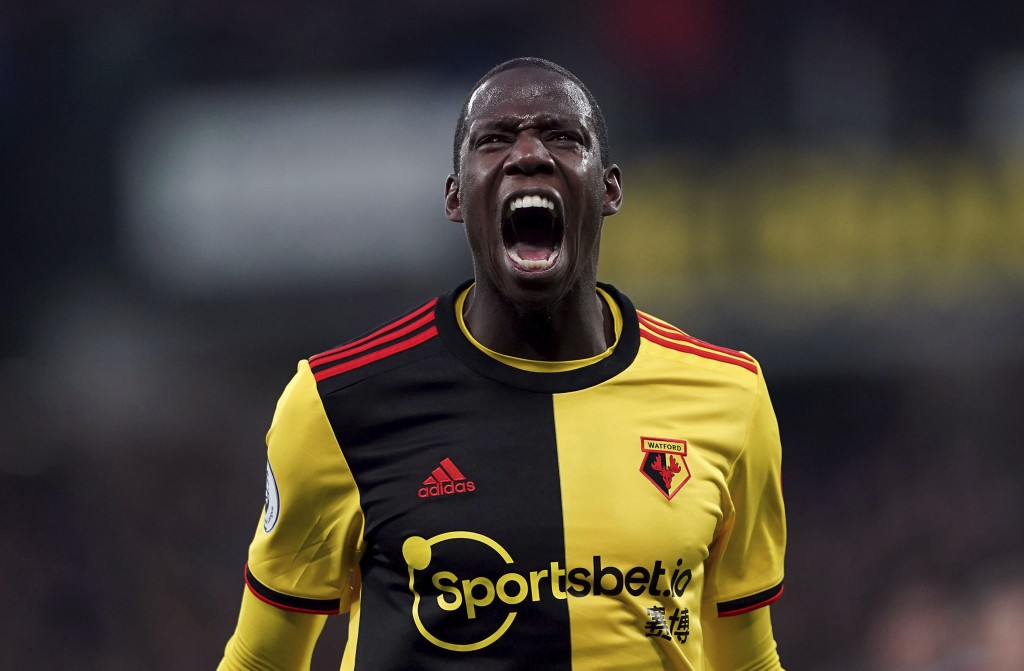 Watford's Abdoulaye Doucoure celebrates scoring against Aston Villa during the English Premier League soccer match at Vicarage Road, Watford, England,...