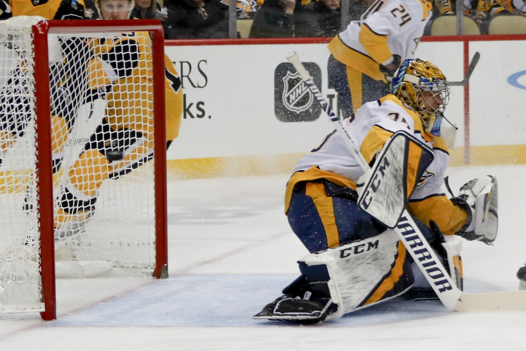 A shot by Pittsburgh Penguins' Alex Galchenyuk gets by Nashville Predators goaltender Pekka Rinne for a goal during the second period of an NHL hockey...