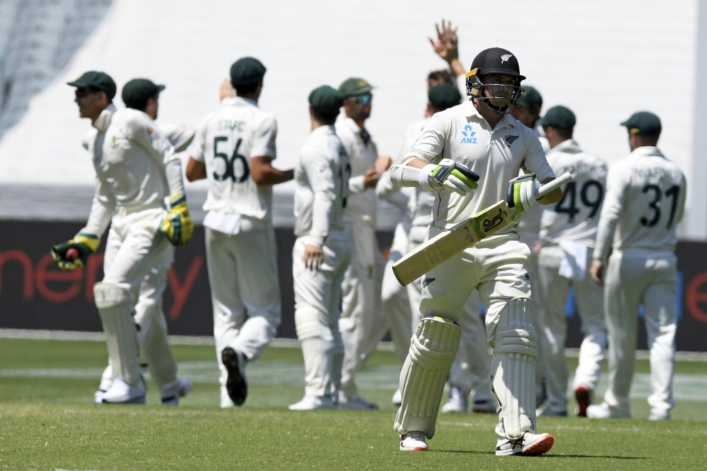 New Zealand's Tom Latham walks off the field after being dismissed by Australia during their cricket test match in Melbourne, Australia, Sunday, Dec. ...