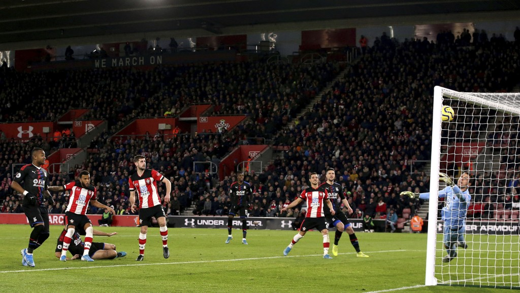 Crystal Palace's James Tomkins, second right, scores against Southampton during the English Premier League soccer match at St Mary's Stadium, Southamp...