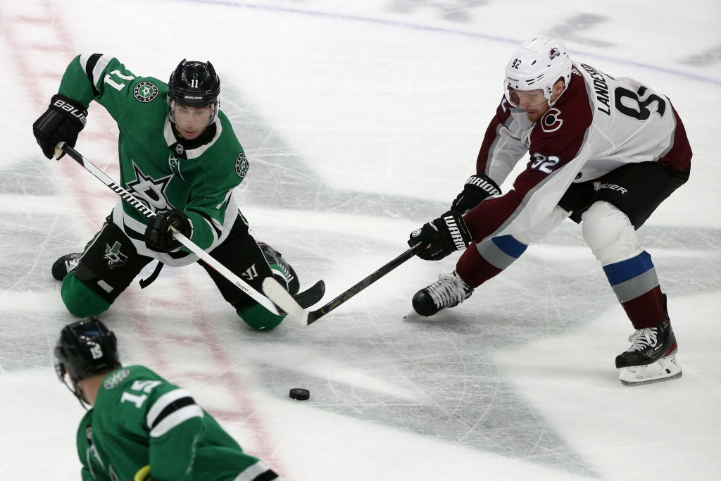 Dallas Stars center Andrew Cogliano (11) and Colorado Avalanche left wing Gabriel Landeskog (92) battle for the puck during the third period of an NHL...