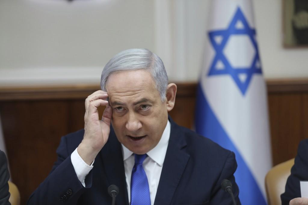 Israeli Prime Minister Benjamin Netanyahu attends the weekly cabinet meeting at his office in Jerusalem, Israel, Sunday, Dec. 29, 2019. (Abir Sultan /...