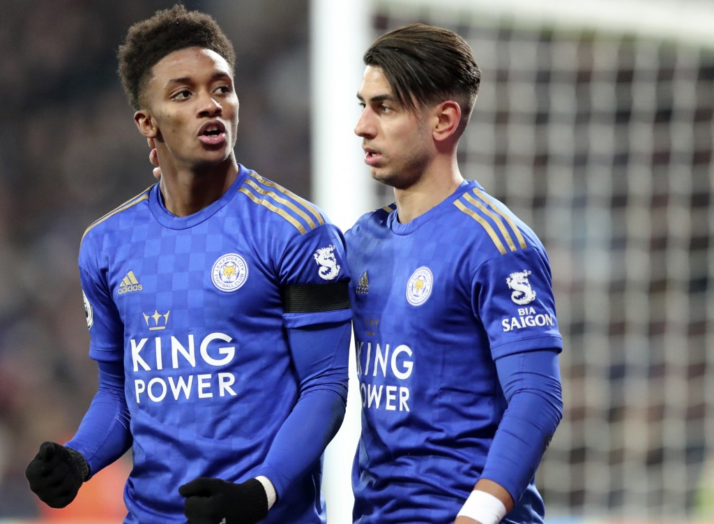 Leicester's Demarai Gray, left, celebrates with Leicester's Ayoze Perez after scoring his side's second goal during the English Premier League soccer ...
