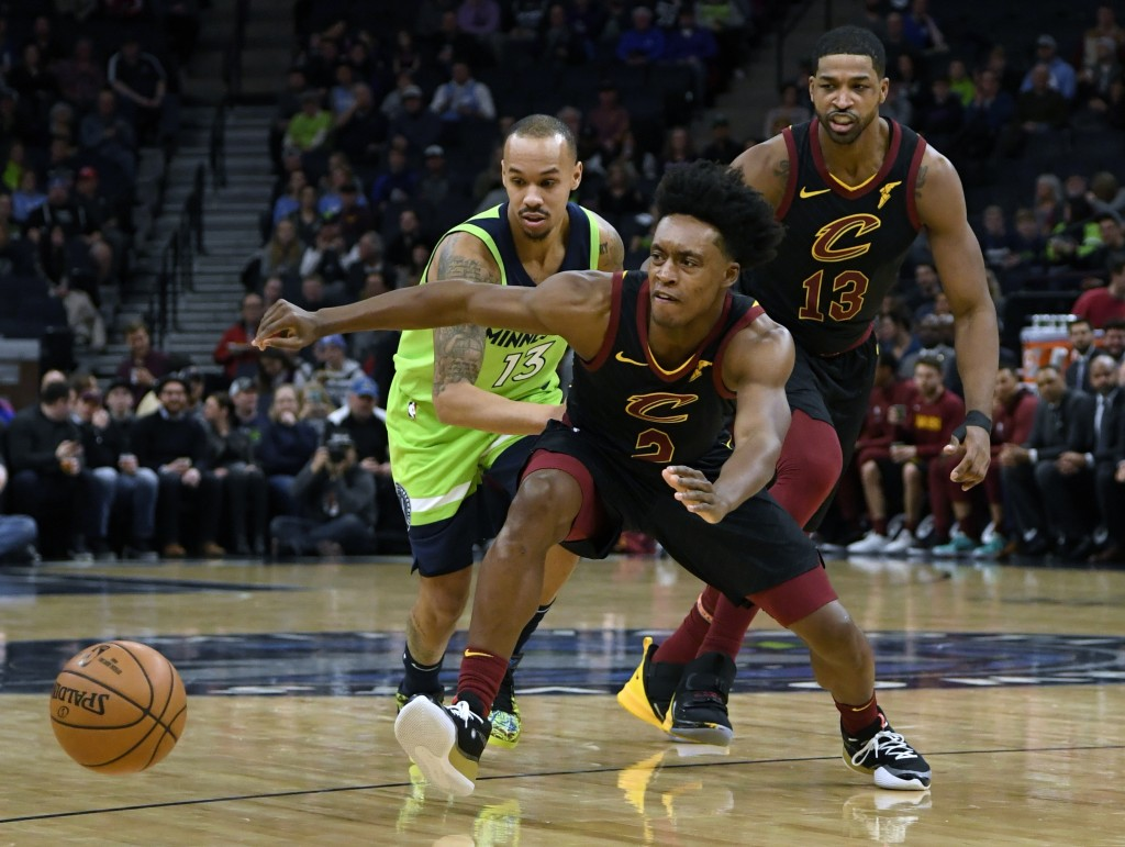 Minnesota Timberwolves' Shabazz Napier (13) and Cleveland Cavaliers' Collin Sexton (2) go after a loose ball as Cleveland Cavaliers' Tristan Thompson ...
