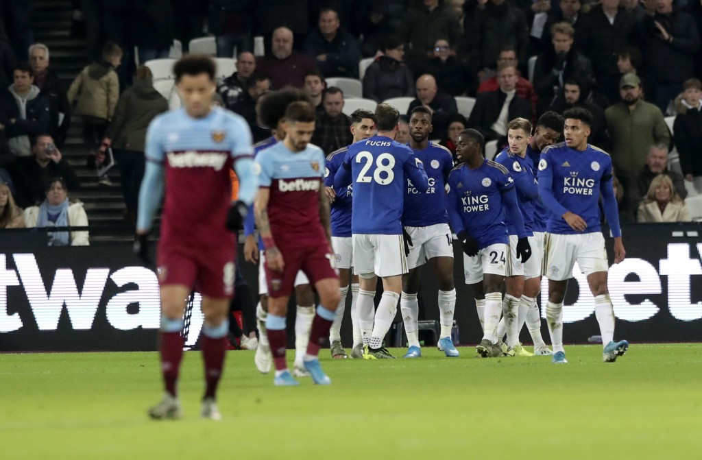 Leicester's Kelechi Iheanacho celebrates with teammates after scoring his side's opening goal during the English Premier League soccer match between W...