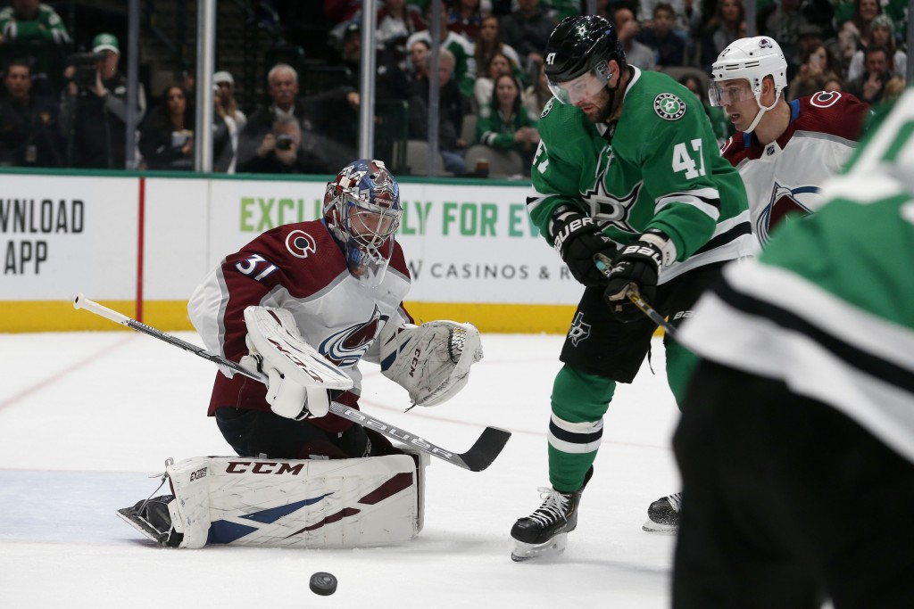 Dallas Stars right wing Alexander Radulov (47) watches as a shot deflects off the pad of Colorado Avalanche goaltender Philipp Grubauer (31) during th...