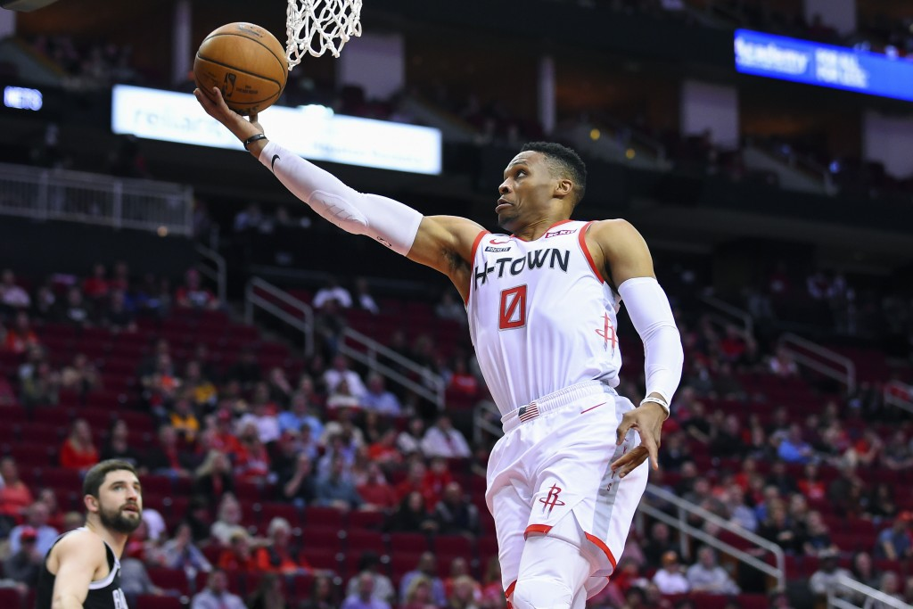 Houston Rockets guard Russell Westbrook (0) drives to the basket during the first half of the team's NBA basketball game against the Brooklyn Nets, Sa...