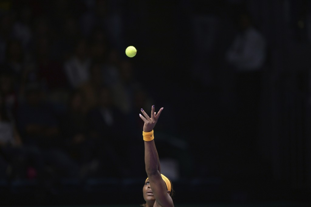 File-This Oct. 22, 2013, file photo shows Serena Williams of the US keeping her eyes the ball as she serves to Angelique Kerber of Germany during thei...