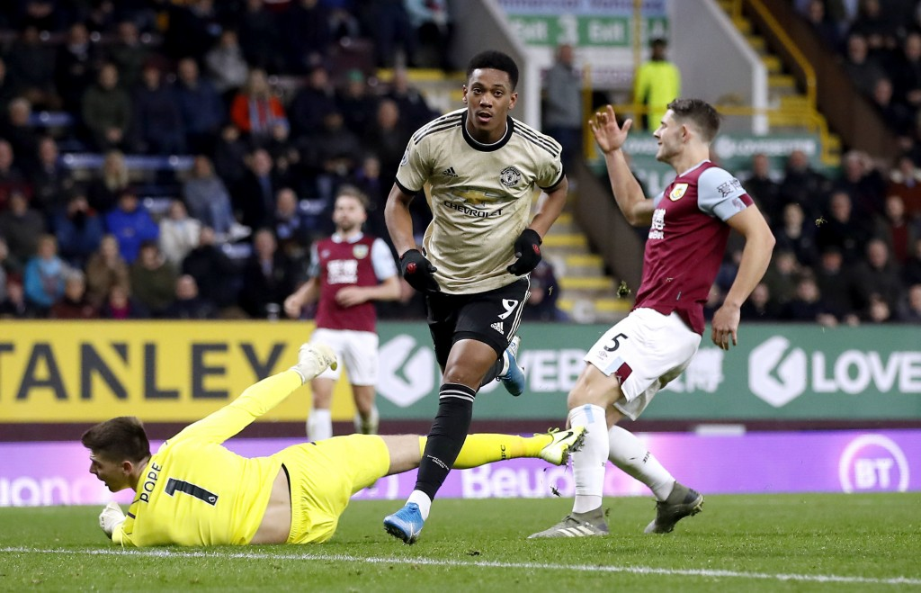 Manchester United's Anthony Martial, center, celebrates scoring against Burnley during the English Premier League soccer match at Turf Moor, Burnley, ...