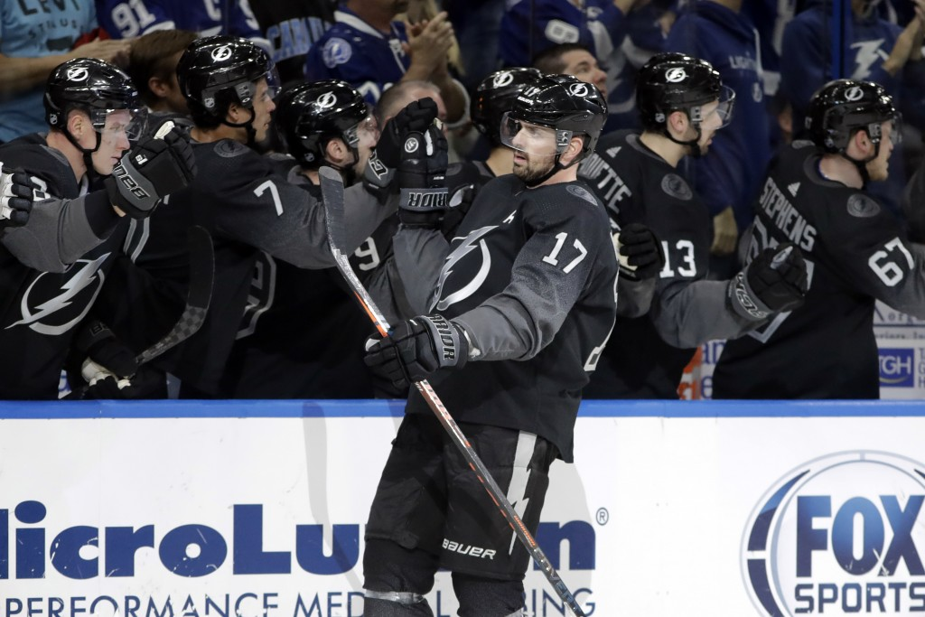 Tampa Bay Lightning left wing Alex Killorn (17) celebrates with the bench after his goal against the Montreal Canadiens during the first period of an ...