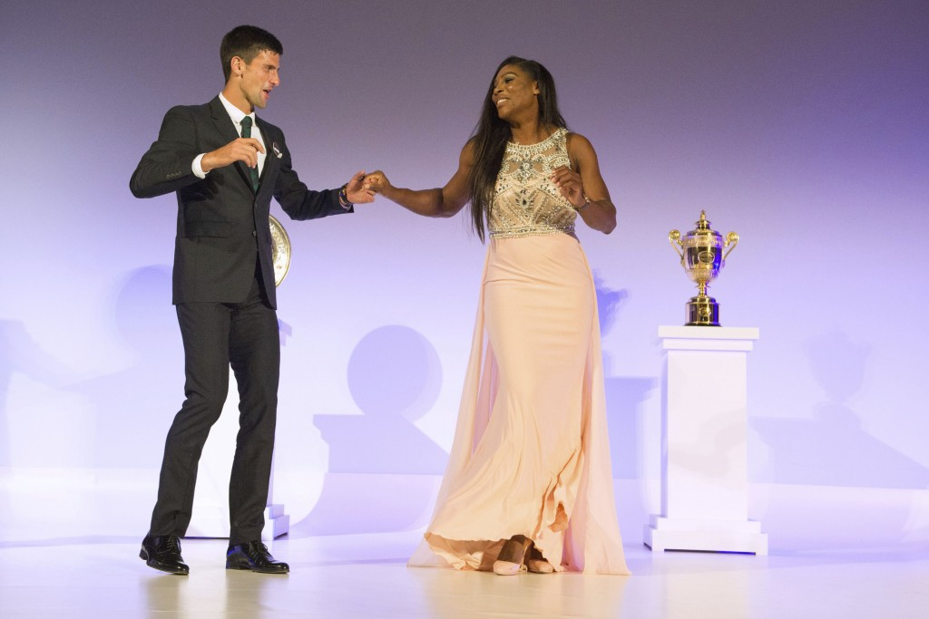File-This July 12, 2015, file photo shows Wimbledon Champions Novak Djokovic of Serbia, left, and Serena Williams of the US, dancing on stage at the W...