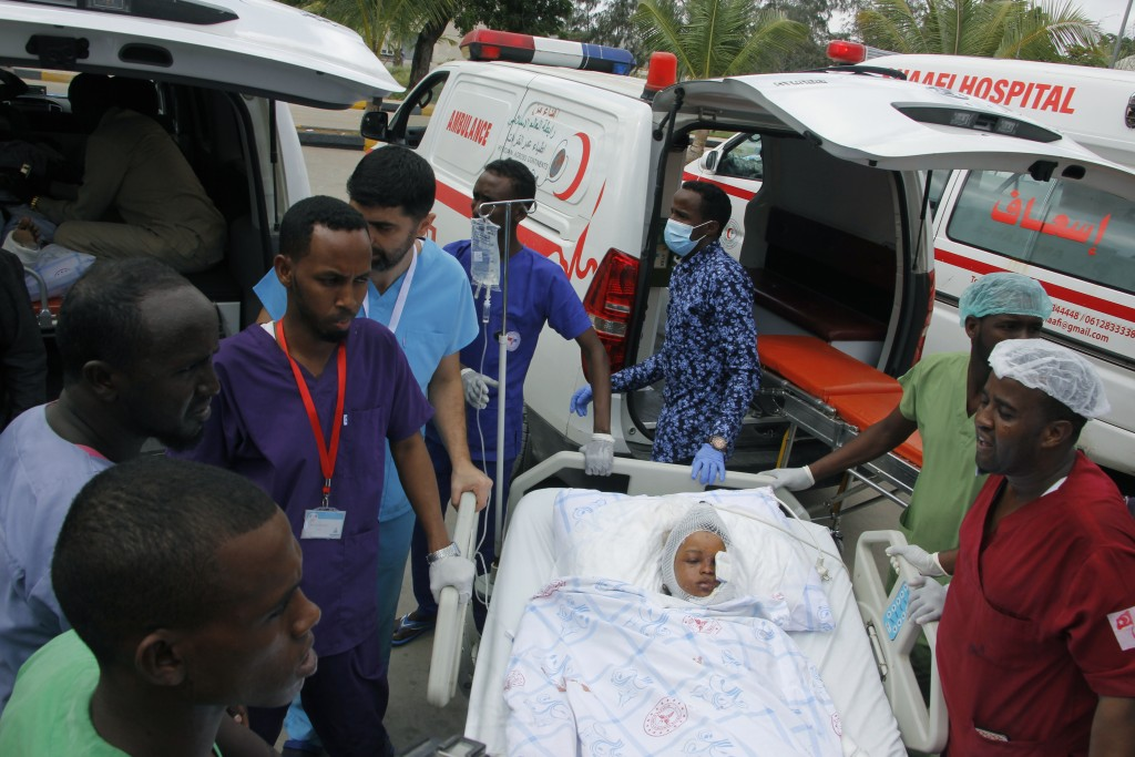 Medical personnel carry a wounded child to be airlifted to the Turkish capital for treatment after they were injured in Saturday's car bomb blast in M...