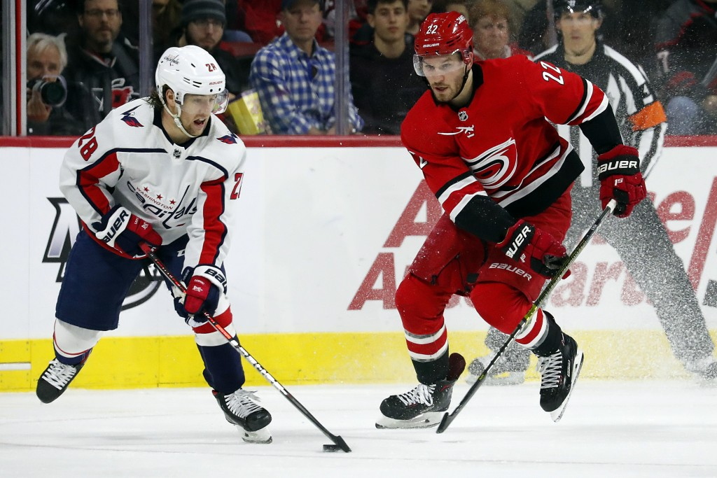 Washington Capitals' Brendan Leipsic (28) works the puck against Carolina Hurricanes' Brett Pesce (22) during the second period of an NHL hockey game ...