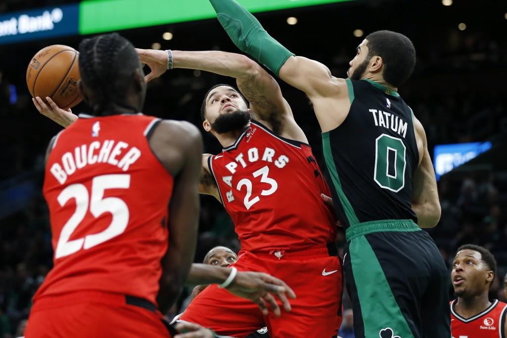 Toronto Raptors' Fred VanVleet (23) shoots against Boston Celtics' Jayson Tatum (0) during the second half on an NBA basketball game in Boston, Saturd...