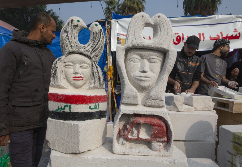 In this Sunday, Dec. 15, 2019, photo, young Iraqi trainees work on sculptures in preparation for their upcoming art exhibition, during the ongoing pro...