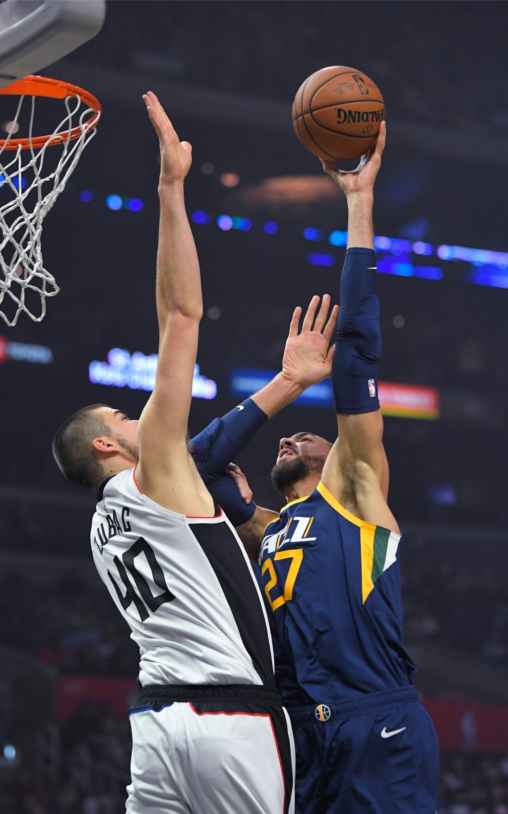 Utah Jazz center Rudy Gobert, right, shoots as Los Angeles Clippers center Ivica Zubac defends during the first half of an NBA basketball game Saturda...