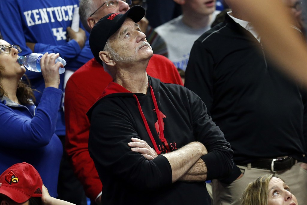 Bill Murray looks at the scoreboard during the first half of an NCAA college basketball game between Kentucky and Louisville in Lexington, Ky., Saturd...