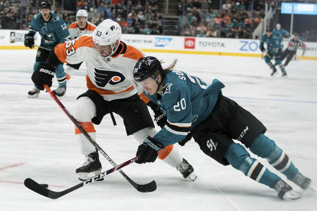 Philadelphia Flyers defenseman Shayne Gostisbehere (53) defends against San Jose Sharks left wing Marcus Sorensen (20) during the first period of an N...