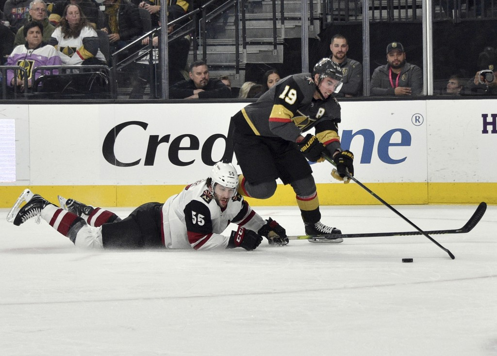 Vegas Golden Knights right wing Reilly Smith (19) skates with the puck next to Arizona Coyotes defenseman Jason Demers during the second period of an ...