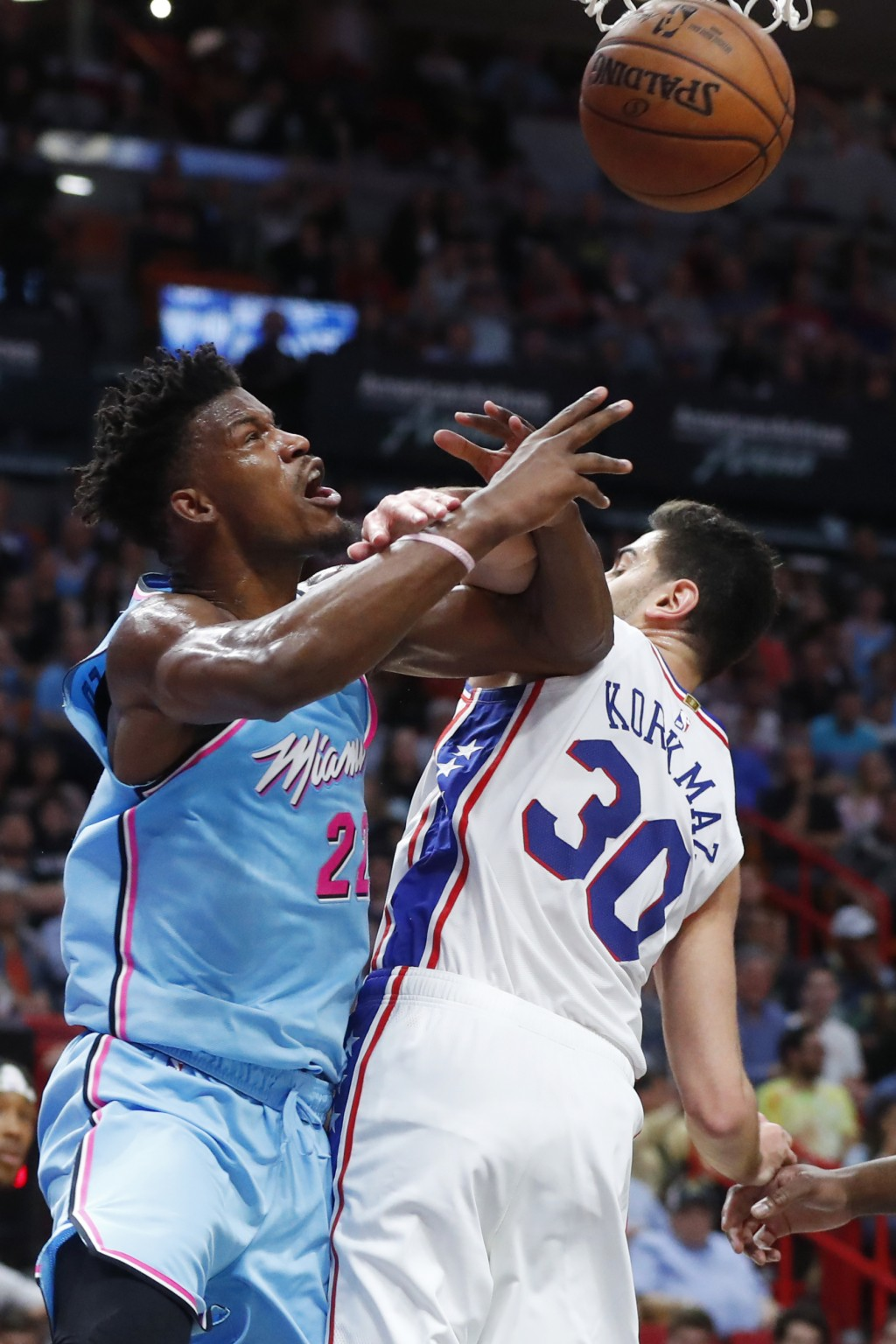 Miami Heat forward Jimmy Butler goes up to shoot against Philadelphia 76ers guard Furkan Korkmaz (30) during the first half of an NBA basketball game,...