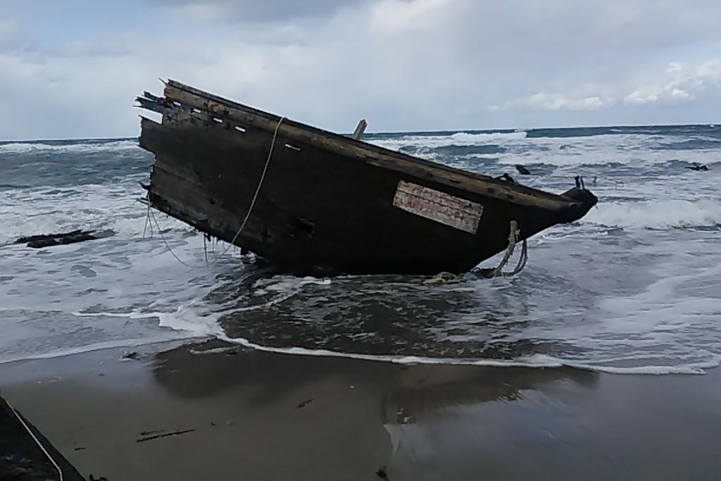 This Saturday, Dec. 28, 2019, photo provided by Sado Coast Guard Station shows a part of a boat on Sado Island, Niigata Prefecture, northern Japan. Th...