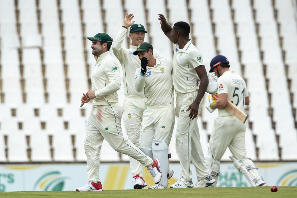 South Africa's bowler Kagiso Rabada, second from right, celebrates with teammates after dismissing England's batsman Jonny Bairstow, far right, for 9 ...