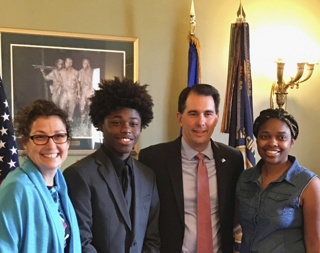 In this Aug. 23, 2017 photo provided by Durante Carr, Amy Gannon, from left, her friend AJ Carr, former Wisconsin Gov. Scott Walker and AJ's mother Do...