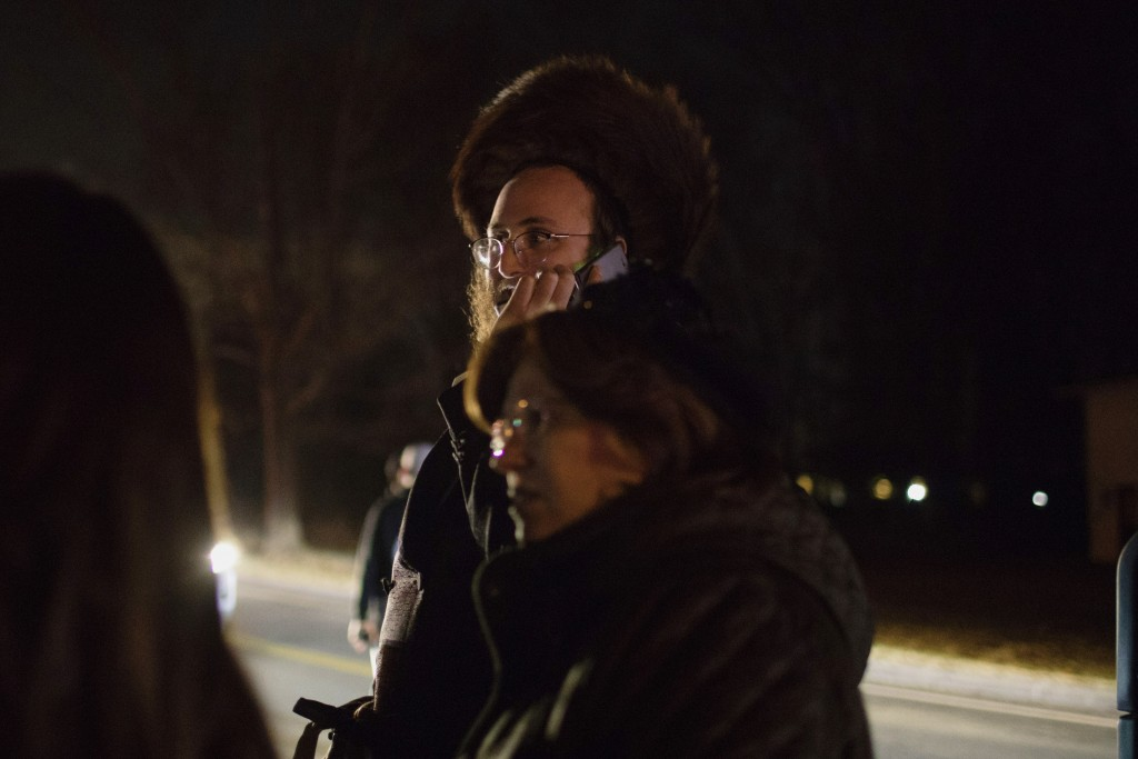 Orthodox Jewish people gather on a street in Monsey, N.Y., Sunday, Dec. 29, 2019, following a stabbing late Saturday during a Hanukkah celebration. A ...