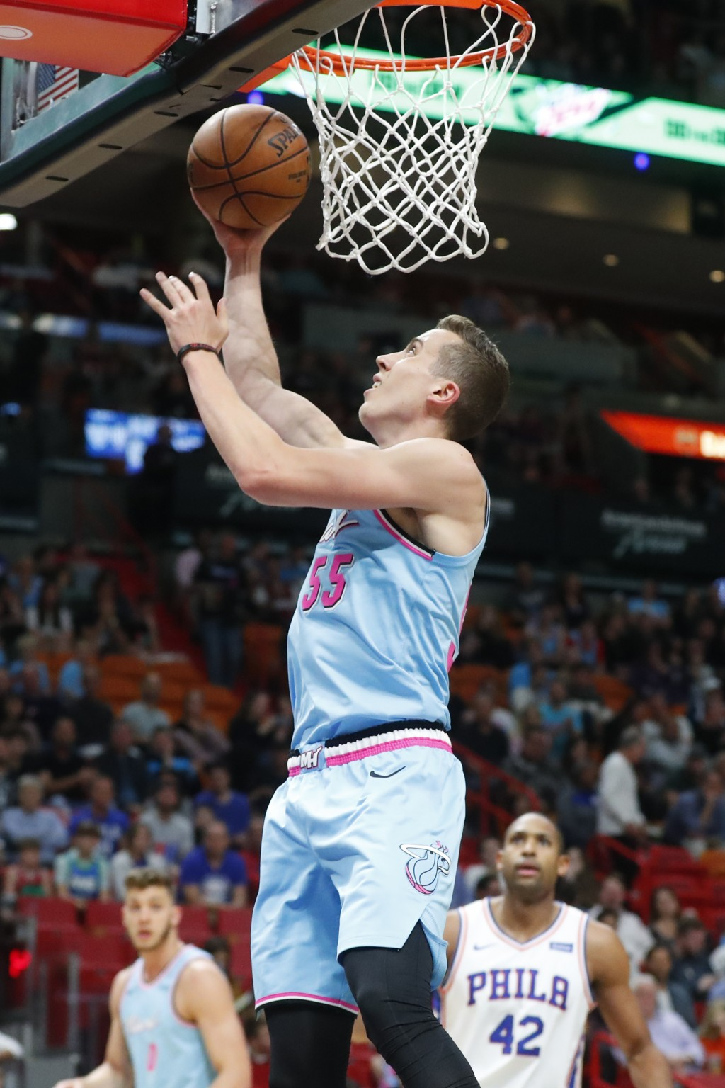 Miami Heat forward Duncan Robinson goes up to shoot during the first half of an NBA basketball game against the Philadelphia 76ers, Saturday, Dec. 28,...