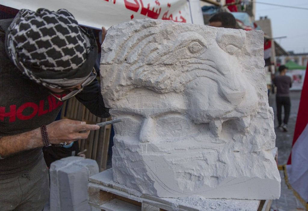 In this Tuesday, Dec. 17, 2019, photo, young Iraqi trainees work on sculptures in preparation for their upcoming art exhibition, during the ongoing pr...