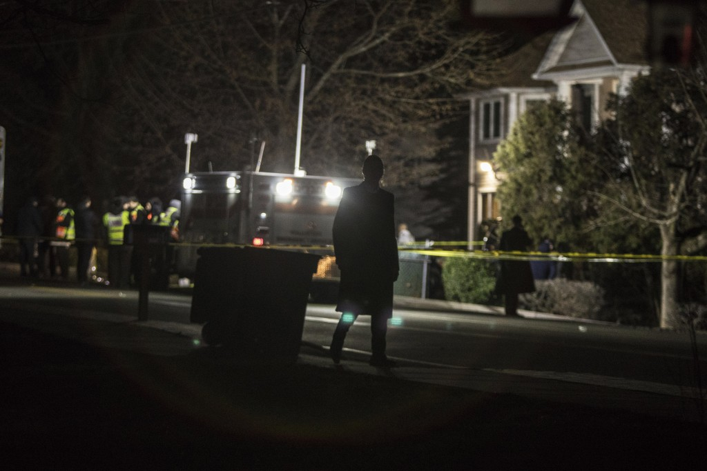 Authorities and first responders gather in front of a residence in Monsey, N.Y., Sunday, Dec. 29, 2019, following a stabbing late Saturday during a Ha...