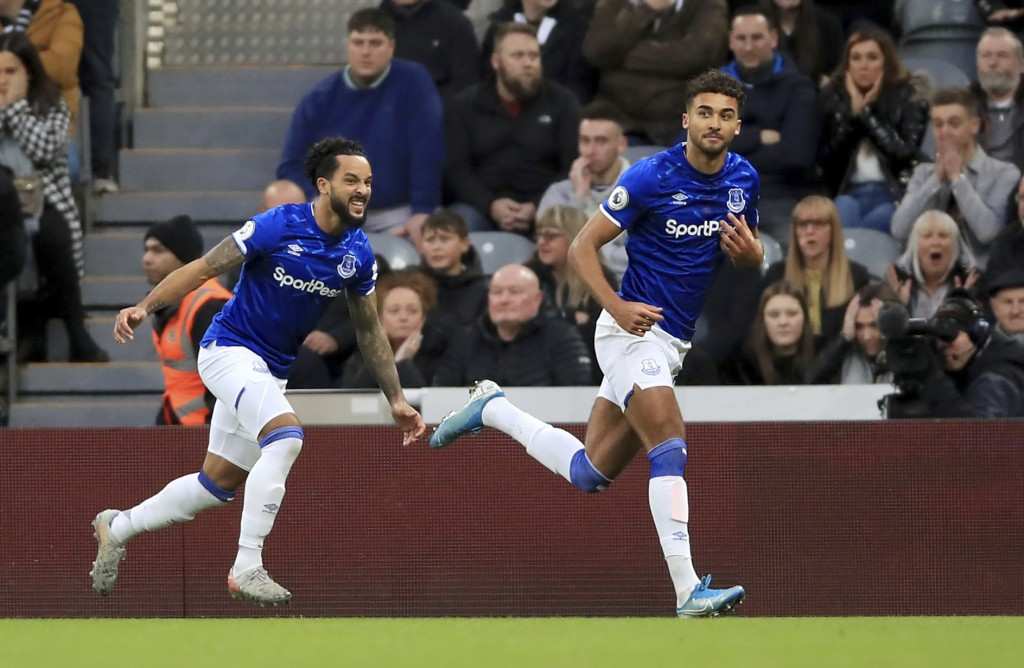 Everton's Dominic Calvert-Lewin, right, celebrates scoring against Newcastle United during the English Premier League soccer match at St James' Park, ...