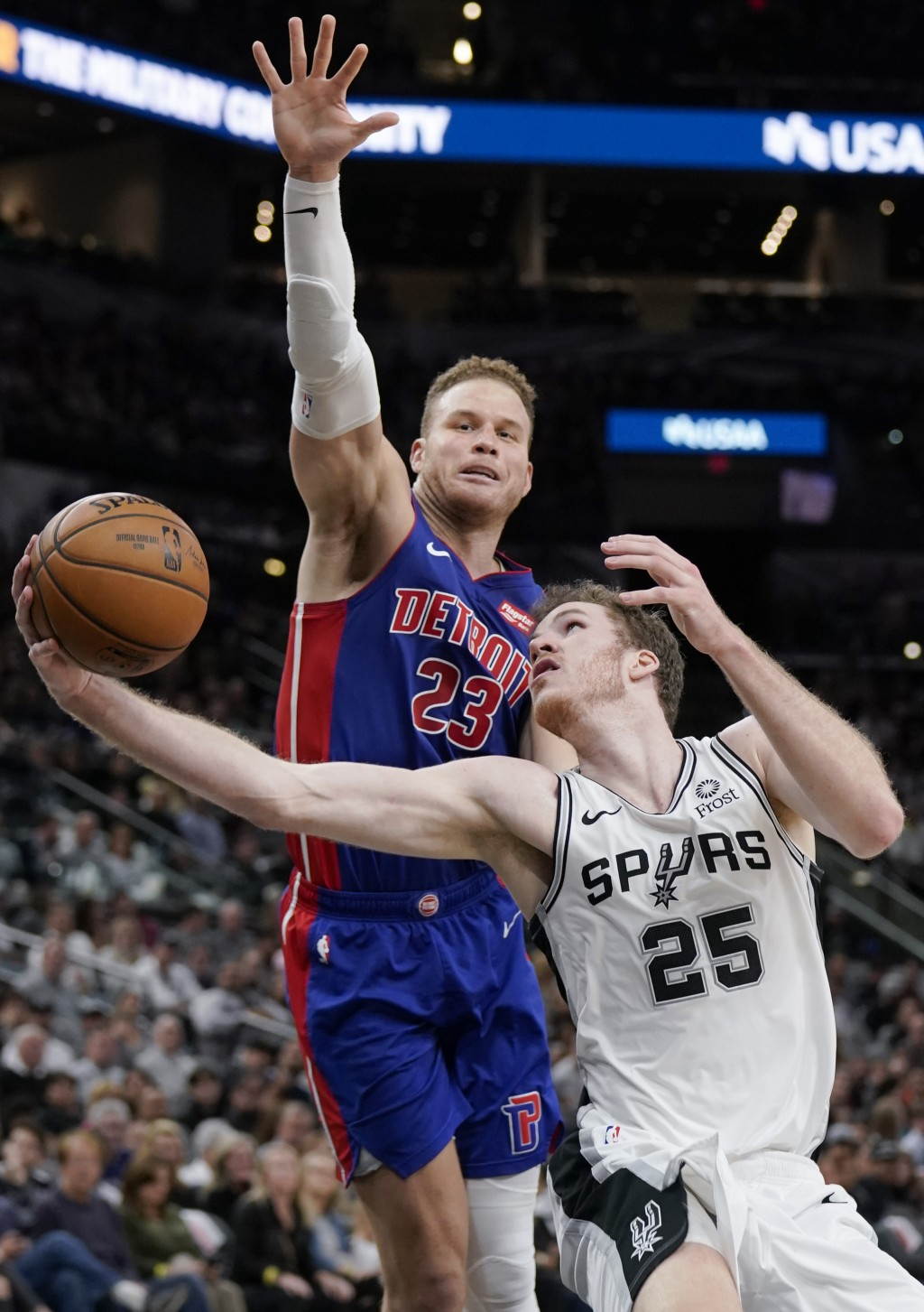 San Antonio Spurs' Jakob Poeltl (25) shoots next toDetroit Pistons' Blake Griffin during the second half of an NBA basketball game Saturday, Dec. 28, ...