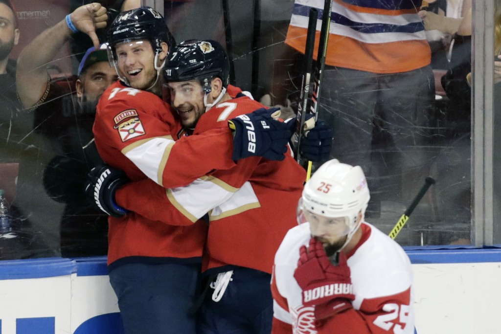 Florida Panthers' Dominic Toninato, left, celebrates with teammate Colton Sceviour, right, after scoring a goal during the second period of an NHL hoc...